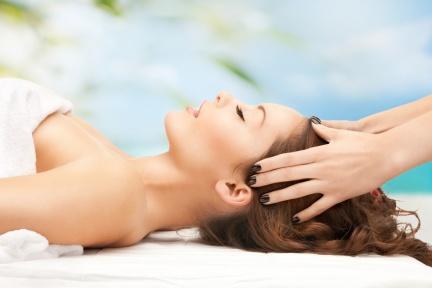woman on resort getting head spa treatment